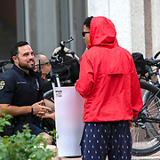 A teenager speaks to an Orlando Police officer prior to a protest at Orlando City Hall on Wednesday, June 3, 2020, in Orlando, Fla., over the death of George Floyd. Floyd died after being restrained by Minneapolis police officers on May 25.  (Alex Menendez via AP)