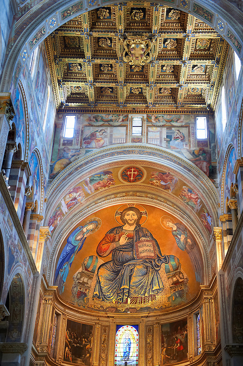 Medieval Byzantine style mosaics of Christ in the interior of the Duomo, Pisa, Italy . The large mosaic in the apse of Christ enthroned between the Virgin and Saint John is famous for the face of Saint John, painted by Cimabue in 1302, which miraculously survived the fire of 1595. This is the last work painted by Cimabue and the only work of his for which we have certified documentation. The work evokes the mosaics of the Byzantine and Norman churches found in Cefalù and Monreale in Sicily. The mosaic, in large part made by Francesco da Pisa, was brought to completion by Vincino da Pistoia with the Madonna on the left side (1320).