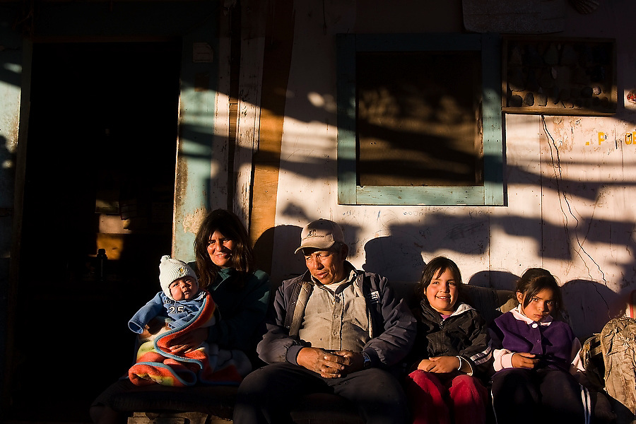 Francisco Arce, an experienced guide to the region's cave paintings and archeological sites, sits with his family at his home in San Francisco de la Sierra, Baja California Sur, Mexico on January 30, 2009. His wife holds their baby son born with blue eyes, a sign of mixed European ancestry.