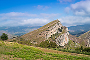 Earth's crust land shifted by earthquake seismic waves and showing rock layers near Caccamo in Northern Sicily, Italy