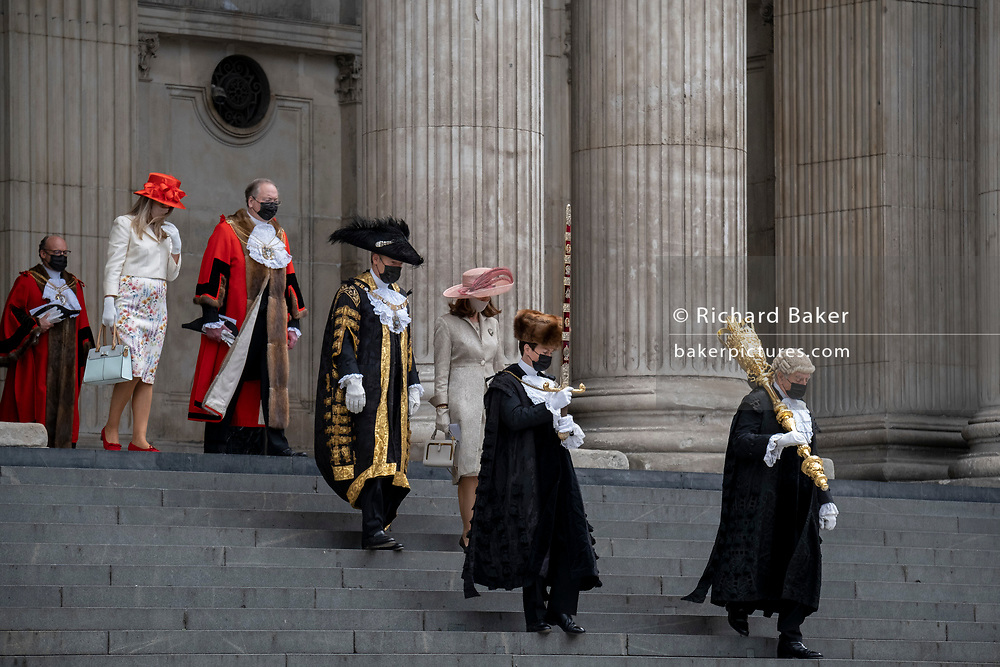 William Russell, the 692nd Lord Mayor of London (in guilded overcoat, centre) and official dignitaries descend the steps of St Paul's Cathedral after the private 'The Lord Mayor's Service of Reconciliation And Hope' function, on 22nd June 2021, in London, England.