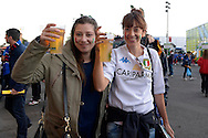 two Italian supporters holding up their drinks outside Twickenham before k/o. Rugby World Cup 2015 pool D match, France v Italy at Twickenham Stadium in London on Saturday 19th September 2015.<br /> pic by John Patrick Fletcher, Andrew Orchard sports photography.