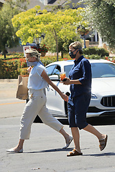 """EXCLUSIVE: Ellen DeGeneres and Portia DeRossi who have been staying inside their fancy home in Santa Barbara, take a break from being cooped up what Ellen described as, her """"prison"""" and head out in their convertible Porsche. The 62 year-old comedian and her 47 year-old wife are spotted enjoying a bit of a wander around Santa Barbara on Memorial Day while wearing masks to guard against possible spreading coronavirus. Seen here heading back to their car, Portia is carrying a bag from Wendy Foster where she seemed like one particular dress. She'd modeled it for Ellen, who pulled her mask down to drink her iced-tea while watching. 23 May 2020 Pictured: Ellen Degeneres, Portia DeRossi. Photo credit: Rachpoot/P&P/MEGA TheMegaAgency.com +1 888 505 6342"""