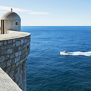 """An outpost overseeing the Adriatic Sea on the old city wall in Dubrovnik, Croatia. <br /> <br /> Dubrovnik serves as the official setting of """"King's Landing"""" from the popular TV show """"Game of Thrones"""".<br /> <br /> LICENSING: This image can be licensed through SpacesImages. Click on the link below:<br /> <br /> http://tinyurl.com/c6ygazz"""