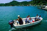 Bay Islands. Roatàn, Oak Ridge, a tiny fishing harbour, children coming back from the school.
