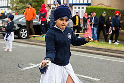 Slough, UK. 28th April 2019. Young Sikhs demonstrate martial arts skills during the Vaisakhi Nagar Kirtan procession. Vaisakhi is the holiest day in the Sikh calendar, a harvest festival marking the creation of the community of initiated Sikhs known as the Khalsa.