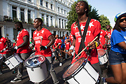 The 49th Notting Hill Carnival in West London. A celebration of West Indian / Caribbean culture and Europe's largest street party, festival and parade. Revellers come in their hundreds of thousands to have fun, dance, drink and let go in the brilliant atmosphere. The Eternity Drum band.