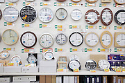 many clocks displayed in a department store