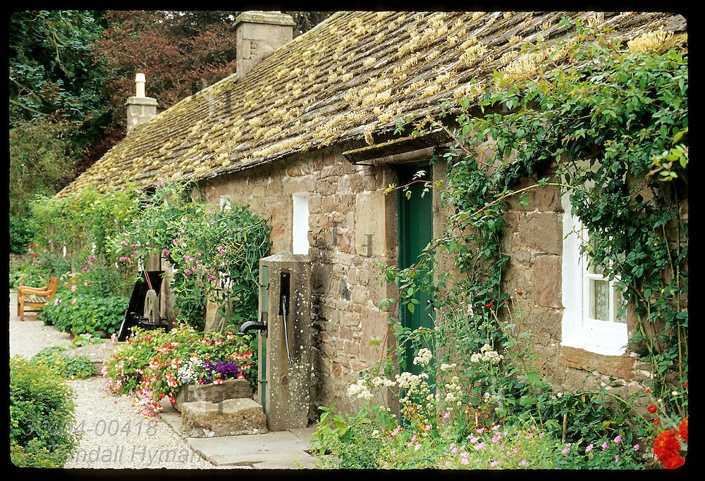 Stone cottages, now the Angus Folk Museum, were built in 1790s to house Glamis Castle estate workers; Glamis, Angus, Scotland.
