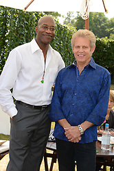 Left to right, Olympic champion athlete EDWIN MOSES and DON FELDER the American musician and songwriter, best known for his work as lead guitarist for the Eagles at the Cartier 'Style et Luxe' part of the Goodwood Festival of Speed, Goodwood House, West Sussex on 14th July 2013.
