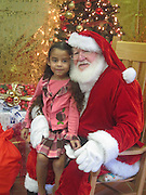 """Halpin Early Childhood Center students enjoyed sitting on Santa's lap to ask for their holiday wishes and to have their pictures taken. The students also celebrated Polar Express Week, in which they made hot chocolate and listened to the book """"Polar Express"""" -- all while wearing their PJ's.<br /> To submit photos for inclusion in eNews, send them to hisdphotos@yahoo.com."""