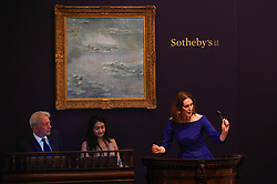 © Licensed to London News Pictures. 19/06/2019. LONDON, UK. Auctioneer Helena Newman fields brings the hammer down on ''Nymphéas'' by Claude Monet, (Est. £25,000,000 - 35,000,000) which sold for a hammer price of £21,000,000 at Sotheby's Impressionist & Modern art evening sale in New Bond Street. This is the first major evening sale to take place after Sotheby's agreed to a takeover by media and telecoms billionaire Patrick Drahi in a deal valued at $3.7bn (£2.9bn).  The big five global auction houses (Sotheby's, Christie's, Bonhams, Phillips and China Guardian Auctions) will now be held privately.  Francois Pinault, another French billionaire, owns Sotheby's traditional rival Christie's.   Photo credit: Stephen Chung/LNP
