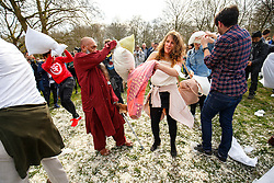 © Licensed to London News Pictures. 02/04/2016. London, UK. Revellers take part in a giant pillow fight in Green Park, London on 'International Pillow Fight Day' on April 2, 2016. Photo credit: Tolga Akmen/LNP