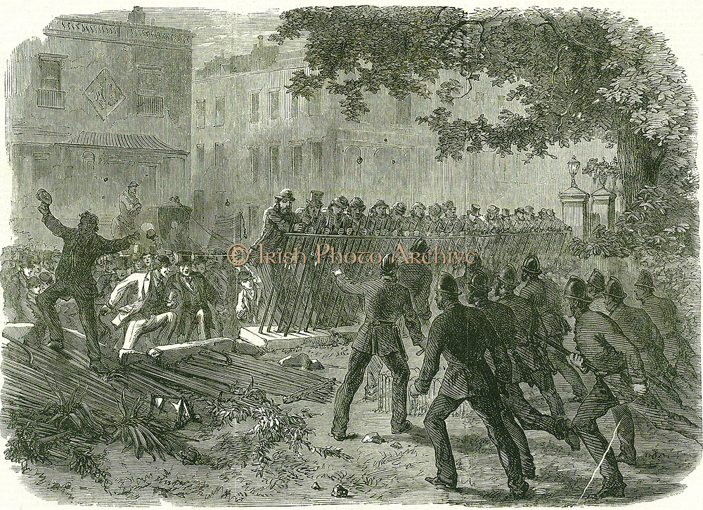 Parliamentary Reform - extension of the suffrage. Police attempted to prevent a Reform meeting in Hyde Park but the demonstrators broke down the park railings  and overwhelmed the police.  From 'The Illustrated London News', 4 August 1866.