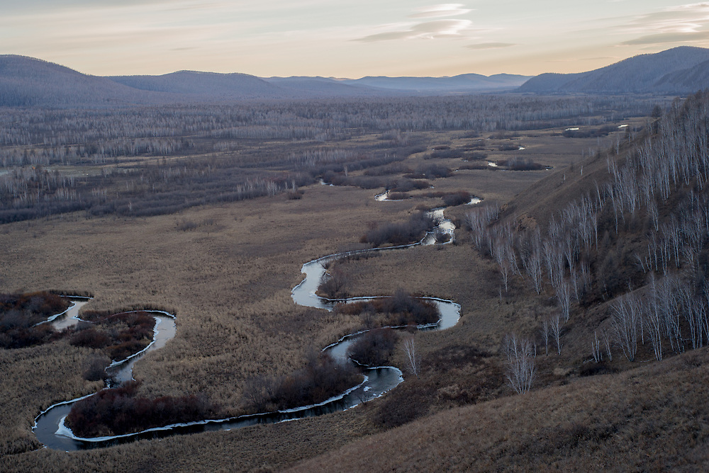 The Hailar river winds through Inner Mongolia Autonomous Region, China. The river flows through both Russia and China.