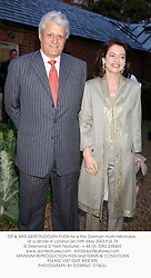 DR & MRS GERT-RUDOLPH FLICK he is the German multi-millionaire, at a dinner in London on 19th May 2003.PJS 78