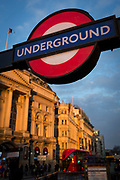 Winter sunshine on a London Underground sign and the Trocadero in Piccadilly Circus, on 6th February 2018, in London, England.