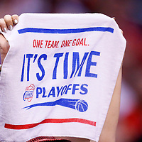 11 May 2014: A Clippers fan waives a towel during the Los Angeles Clippers 101-99 victory over the Oklahoma City Thunder, during Game Four of the Western Conference Semifinals of the NBA Playoffs, at the Staples Center, Los Angeles, California, USA.