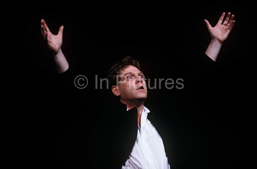 With a dark background as black as his jacket, a wide-eyed young Shakespearean Kenneth Branagh reaches up theatrically to make a dramatic point during his acting role as Hamlet in the Royal Shakespeare Company's (RSC) production that took the biggest advance in its 32-year history – £1.3m, which opened at the Barbican Centre in London last weekend then transferred to Stratford upon Avon in the spring. Branagh received largely favourable reviews for his performance in the title role in Adrian Noble's production.