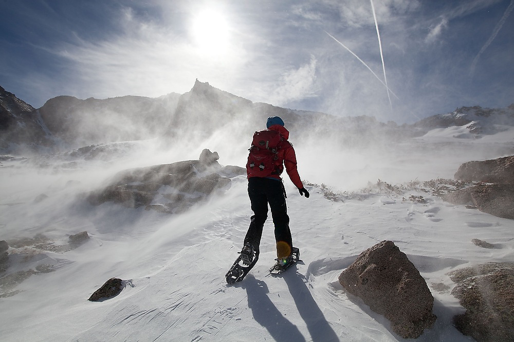 Grace Marx is surrounded by blowing snow in the alpine basin above Black Lake in Rocky Mountain National Park, Colorado.