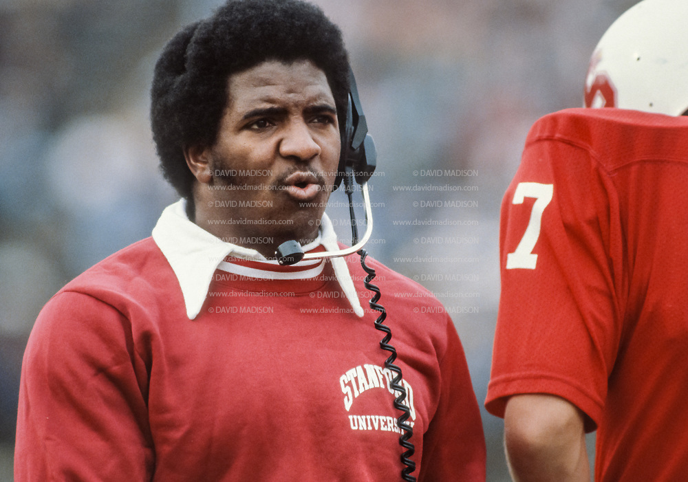 BERKELEY, CA - NOVEMBER 22:  Dennis Green, Stanford University Offensive Coordinator, coaches Stanford quarterback John Elway #7 during the 1980 Big Game between Stanford and the California Golden Bears played November 22, 1980 at Memorial Stadium in Berkeley, California. (Photo by David Madison/Getty Images)