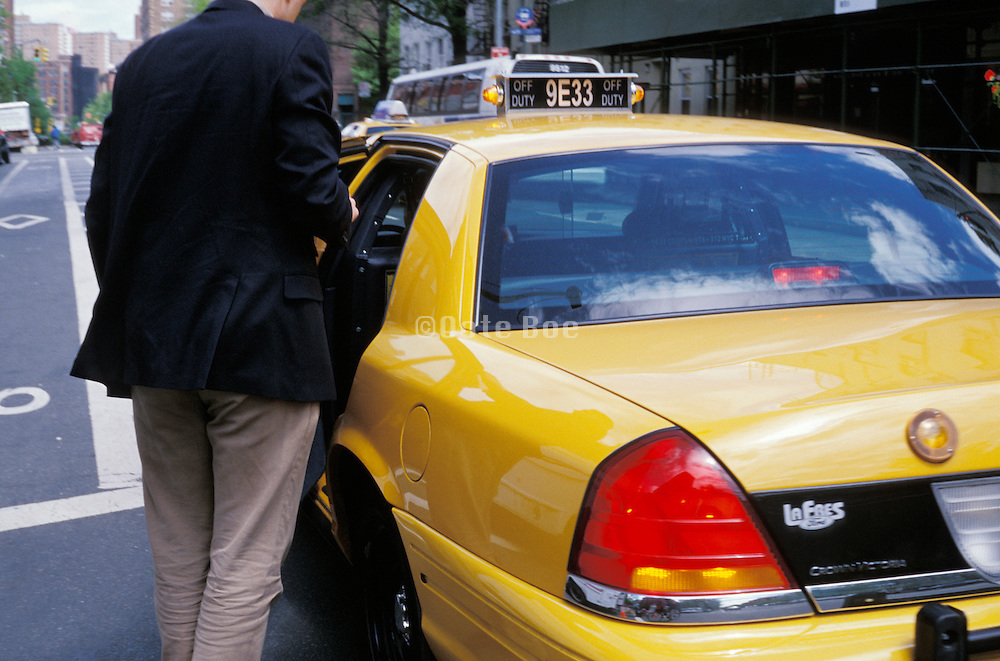 man entering taxi cab