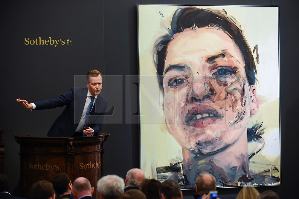 © Licensed to London News Pictures. 26/06/2019. LONDON, UK. Oliver Barker, Chairman, Sotheby's Europe, fields bids for ''Shadow Head'' by Jenny Saville, (Est. £3,000,000 - 5,000,000) which sold for a hammer price of £3,500,000 at Sotheby's Contemporary Art Evening Sale in their New Bond Street galleries.  Photo credit: Stephen Chung/LNP