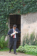 Xavier Perromat, winemaker, coming out from the wine cellar with a bottle of wine Chateau de Cerons (Cérons) Sauternes Gironde Aquitaine France