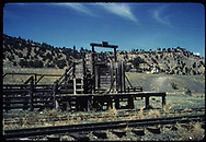 D&RGW stock chute at Gato with church in background.<br /> D&RGW  Gato (Pagosa Junction), CO  <br /> Thanks to Don Bergman for additional information.