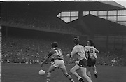 Kerry attempts to grab the ball while chased by two Dublin players during the All Ireland Senior Gaelic Football Final Dublin v Kerry in Croke Park on the 26th September 1976. Dublin 3-08 Kerry 0-10.