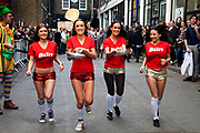 Team from The Sun Newspaper at the Great Spitalfields Pancake Race on Shrove Tuesday, pancake day, at the Old Truman Brewery, London, UK. This is a fun quirky annual event where competitors come as teams of four people dressed up in costume. Organised by Alternative Arts raising money for charity.