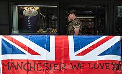 """Members of the army in Westminster, London, after Scotland Yard announced armed troops will be deployed to guard """"key locations"""" such as Buckingham Palace, Downing Street, the Palace of Westminster and embassies."""