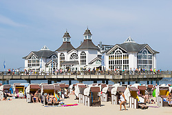View of Pier and many traditional Strandkorb beach chairs on beach at Sellin resort on  Rugen Island , Mecklenburg-Vorpommern Germany