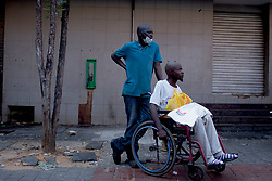 May 15, 2020, Pretoria, Gauteng, South Africa: A disable person waits for his friend at the food distribution at Pretoria central, South Africa on 15th May 2020 (Credit Image: © Manash Das/ZUMA Wire)