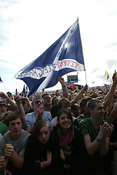 A saltire as Arcade Fire plays on the main Stage, at T in the Park, Saturday 7 July 2007..T in the Park festival took place on the 6th, 7th and 8 July 2007, at Balado, near Kinross in Perth and Kinross, Scotland. This was the first time the festival had been held over three days..Pic ©Michael Schofield. All Rights Reserved..