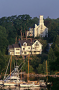 Boats moored in Rockport harbor former Rockport United Methodist Church Maine.