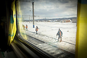Railway workers seen from a cabin on the BAM (Baikal-Amur Mainline), Siberia. Russia