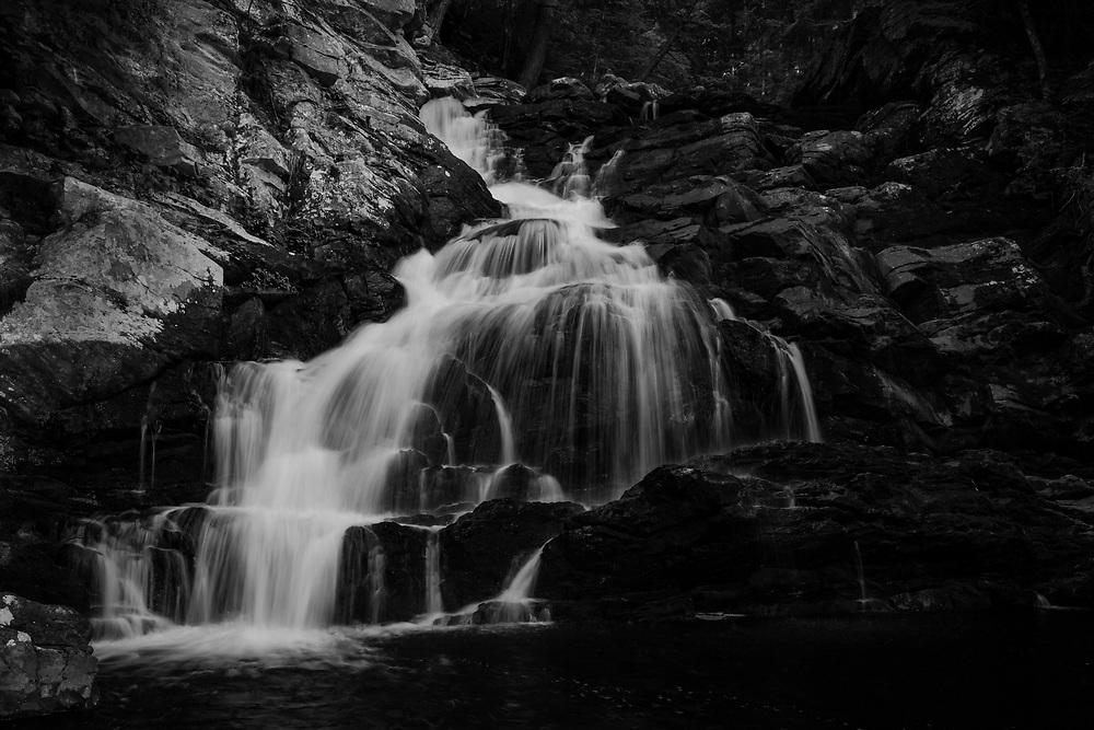 Cold spring water flowing through the cascades of Wahconah Falls.