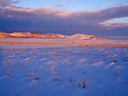 Setting sun following departing storm illuminating Moonstone Mountain east of Fairfield, Idaho.