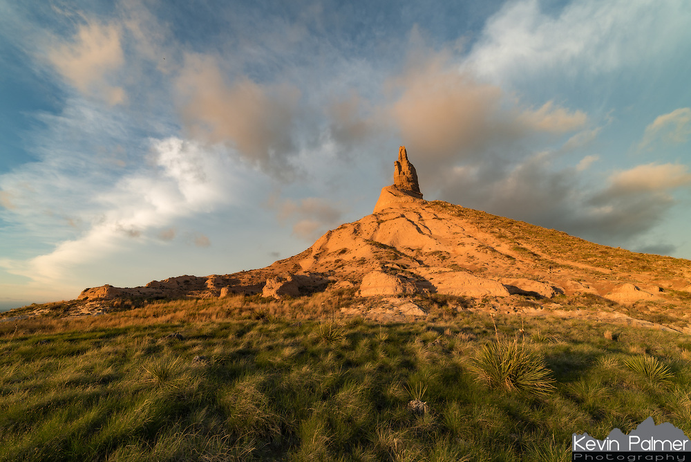 One of the most notable landmarks on the Oregon Trail, Chimney Rock towers hundreds of feet above the surrounding plains in the Nebraska panhandle. The pillar was at least 10% taller 150 years ago, but it has since been weathered down by wind, erosion, and lightning. I was glad to be able to capture some nice light at sunset on the west side of the rock formation, even though it didn't last long. The anvil in the distance is from a thunderstorm which produced a tornado nearby a couple hours earlier.