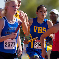 051014       Cable Hoover<br /> <br /> Valley Sanders Pirate Cherelle Speen works her way through the pack in the first leg of the 4x800 relay during the Arizona State Track Meet at Mesa Community College Saturday.
