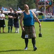 Highland Games, 3rd of August 2019, Newtonmore, Scotland, United Kingdom. A competitor gets ready to compete in Throwing the Weight. The Highland Games is a traditional annual event where competitors compete as strong men, runners, dancers, pipers and at tug-of-war. The games go back centuries and are happening through-out the summer across Scotland. The games are both an important event locally and a global tourist attraction.