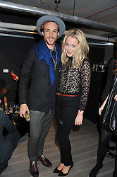 GERAUD PFEIFFER and POPPY JAMIE at Diego Bivero-Volpe's 30th birthday party in aid of the charity Kids Company held at the Rook & Raven Gallery, 7 Rathbone Place, London W1 on 12th April 2013.