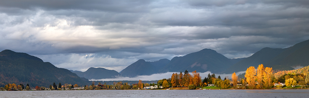 View of fall leaves on Hatzic Island and the mountains north of Hatzic Lake, British Columbia, Canada.  Photographed from Neilson Regional Park in Mission, BC.