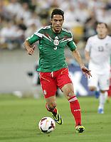 Mexico's Aldo De Nigris Guajardo against New Zealand in the World Cup Football qualifier, Westpac Stadium, Wellington, New Zealand, Wednesday, November 20, 2013.