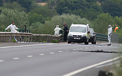 ©Licensed to London News Pictures 16/07/2020     <br /> Tonbridge, UK. Forensic officers working on the  coast bound carriageway, The burn out car was on the coast bound carriageway it has now been removed. A woman has died and a man has been arrested following a car fire on the A21 near Tonbridge in Kent. A police cordon is in place and the A21 is closed. Photo credit: Grant Falvey/LNP