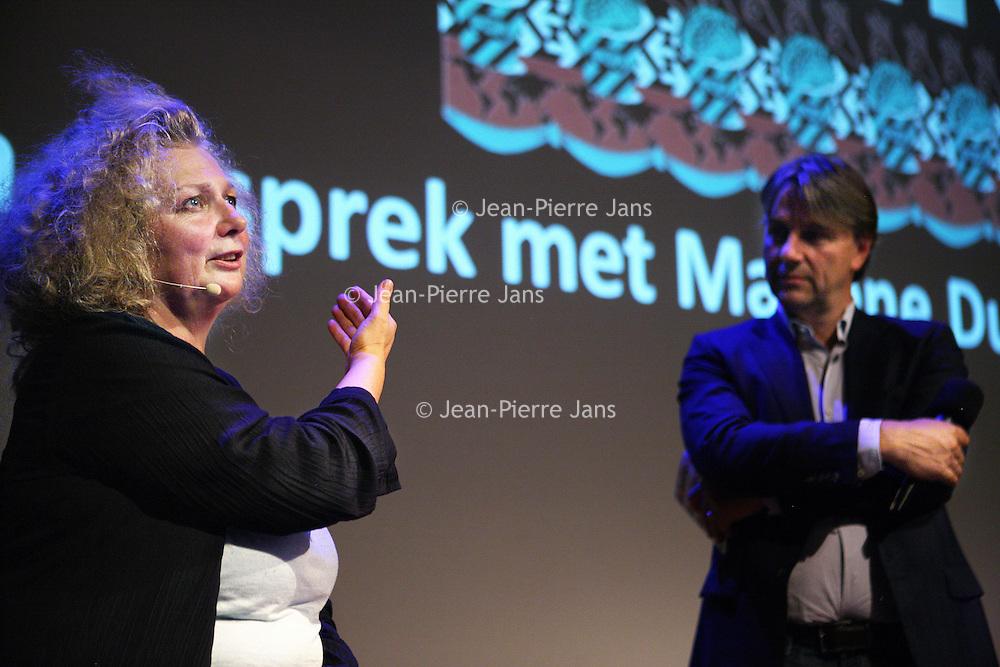 Nederland, Amsterdam , 11 september 2013.<br /> In de Balie.<br /> Een gesprek met kunstenares Marlene Dumas.<br /> Marlene Dumas (Kaapstad, 3 augustus 1953) is een in Zuid-Afrika geboren kunstenares. Zij woont en werkt sinds 1976 in Amsterdam en wordt als een Nederlandse kunstenares beschouwd.<br /> Dumas wordt geinterviewd door journalist en directeur van de Balie Yoeri Albrecht.<br /> A public conversation with artist Marlene Dumas in cultural center De Balie in Amsterdam.<br /> Foto:Jean-Pierre Jans
