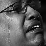 """A spectator cries, reacting while watching the inauguration ceremony of Barack Obama on jumbotron screens on the National Mall, January 20, 2009. Obama took the oath as the nation's 44th, and first African-American, President.     ltqmb   """"Faces 3"""""""