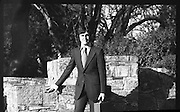 Austin Reed Fashion Shoot..1972..14.11.1972..11.14.1972..14th November 1972..To launch some of the new Austin Reed range of clothes a photo shoot was held at St Stephen's Green, Dublin...Picture shows the model wearing a dark grey,double knit Jersey wool suit. The suit is single breasted with two buttons and is priced at £45. To complete the look he is wearing a John Weitz shirt in navy and white cotton at £5.95.A John Weitz pure silk tie at £2.95 and black ,Portugese leather,shoes at £11.25.
