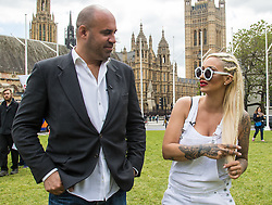 """Westminster, London, May 24th 2016. Animal rights protesters from """"Boycott Dogs4Us"""" protest outside Parliament against puppy farming and third party puppy selling as the Environment, Food and Rural Affairs Sub-Committee are investigating the sale of dogs as part of their animal welfare inquiry. PICTURED: TV Vet Marc Abraham and Jodie Marsh."""